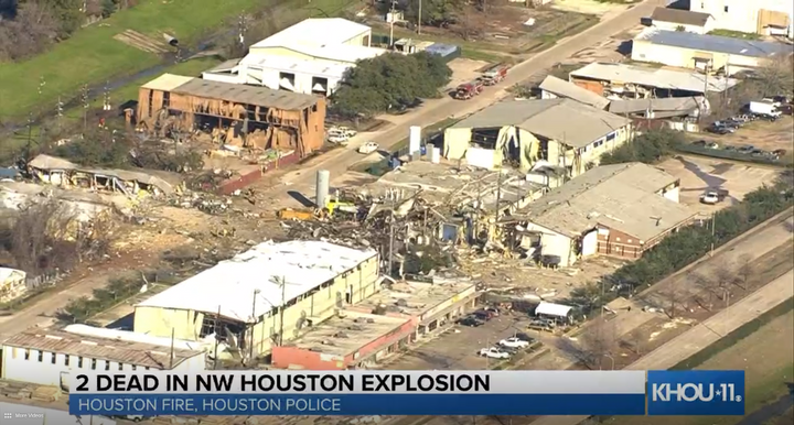 Firefighters comb the debris after an explosion tore apart a machining plant in northwest Houston Friday morning. - Screencapture Via KHOU
