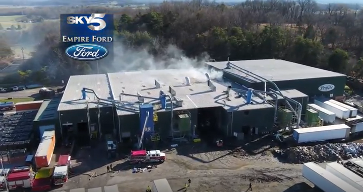 Smoke pours from the Profile Products paper recycling plant in Limestone, Tennessee. - Screenshot via WCYB