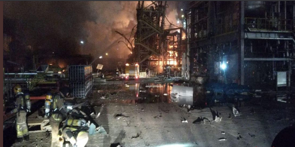 Fire still glows from the wreckage of a chemical plant in Tarragona, Spain.