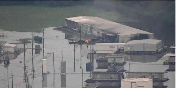 Fire ignites the first of three trailers containing organic peroxide to burn at Arkema Chemicals...