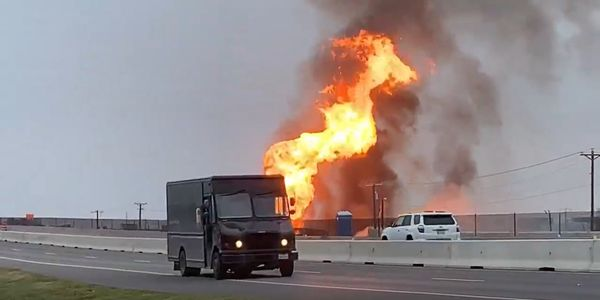 Flames from a ruptured pipeline rise above Interstate 37 in Corpus Christi, Texas.