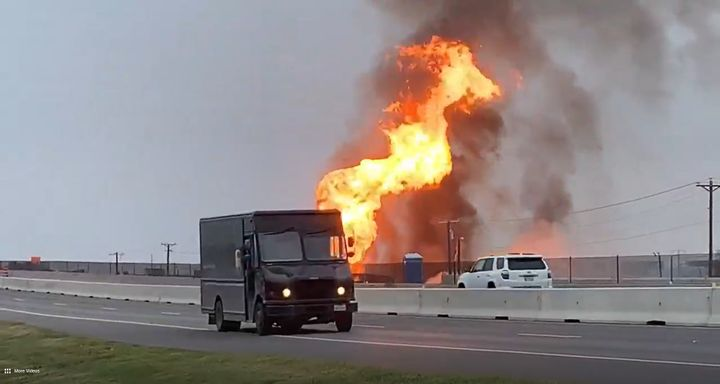 Flames from a ruptured pipeline rise above Interstate 37 in Corpus Christi, Texas. - Screencapture Via KIII