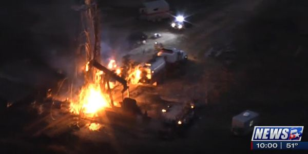 Aerial view of the burning oil well after a blowout Jan. 30 responsible for three deaths.