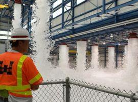 A foam deluge system activated inside an aircraft hangar.
