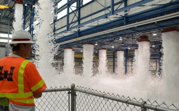 A foam deluge system activated inside an aircraft hangar. - Courtesy of the U.S. Army Corps of Engineers
