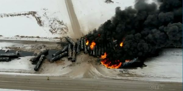 Oil tanker cars continue to burn more than 24 hours after a freight train derailed in Saskatchewan.