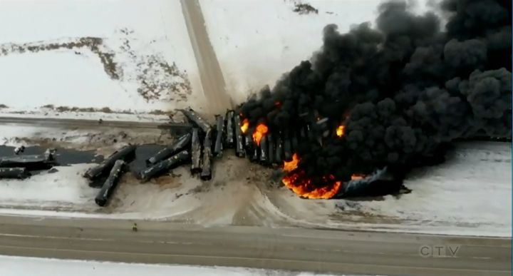 Oil tanker cars continue to burn more than 24 hours after a freight train derailed in Saskatchewan. - Screencapture Via Global News