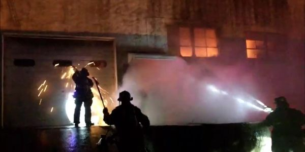 Hackensack New Jersey firefighters doused growing flames at a cosmetics factory.