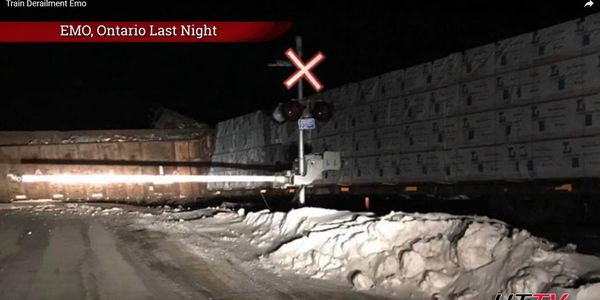 At least two rail cars out of 26 containing crude were reported as leaking after a derailment...