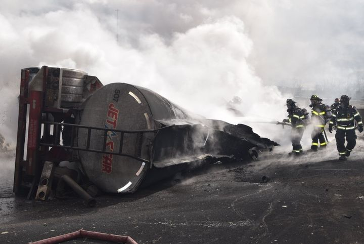 Firefighters deal with the smoking ruin of a fuel tanker that caught fire in Indianapolis. - Photo courtesy of Indianapolis Fire Department.