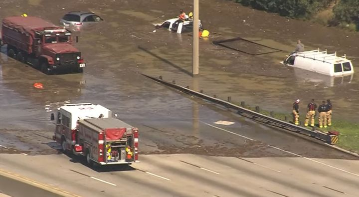 Firefighters deal with flooding in the wake of a water main break in Houston Thursday. - Screencapture from KHOU