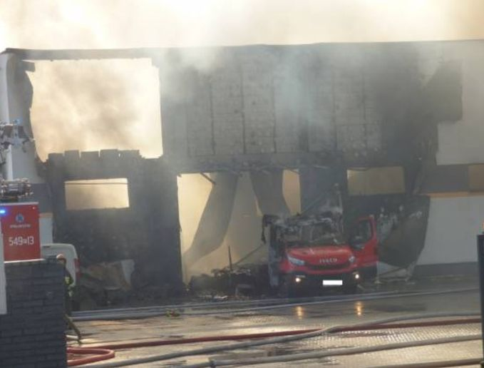 Flames gutted the production hall at a textile factory in Poland Saturday. - Photo Courtesy of KP PSP Ostrzeszow