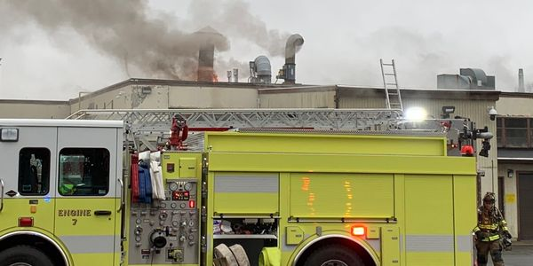 A quick photo taken on arrival at the gun factory shows flames breaking through the roof.