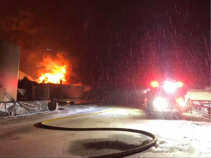 A driving snow storm further complicated firefighting efforts at a Colorado oil production site Monday. - Courtesy of Platteville-Gilcrest Fire Protection District