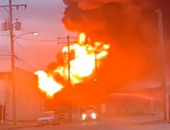 A fireball blossoms above a burning tire recycling plant in Richmond, Virginia, Tuesday. - Screencapture Via WWBT