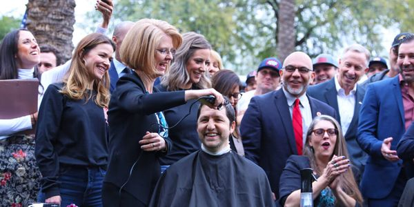 Arizona State Senator Paul Boyer has his head shaved in support of his bill to identify any...