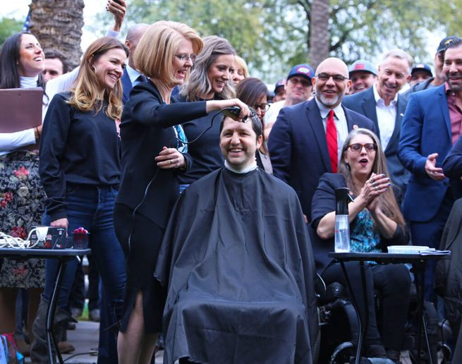 Arizona State Senator Paul Boyer has his head shaved in support of his bill to identify any firefighter suffering cancer as having an occupation illness. His barber is bill co-sponsor Heather Carter. - Courtesy of Heather Carter