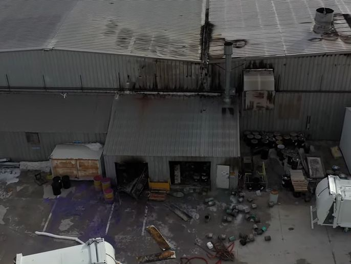 Fire damage from a Monday blaze at a truck factory in Scranton, Iowa, is apparent. - Screencapture Via YouTube