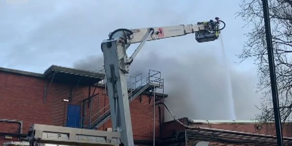 An aerial ladder delivers water to an industrial bakery fire in Wakefield, UK.