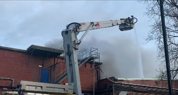 An aerial ladder delivers water to an industrial bakery fire in Wakefield, UK. - Screencapture Via BBC