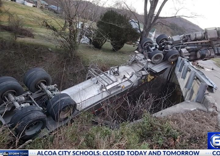 An overturned tanker carrying hazardous material crashed down onto a railroad line in Williamsburg, Kentucky, Monday. - Screencapture Via WATE