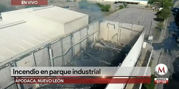 Firefighters overhaul the flame gutted interior of a warehouse in Apodaca, Mexico.