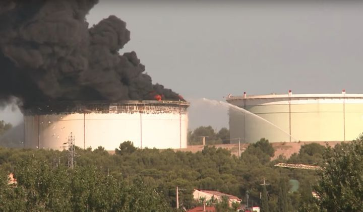 Added by explosives, two storage tanks at a Lyondell-Basell refinery in France caught fire in 2015. - Screencapture Via YouTube