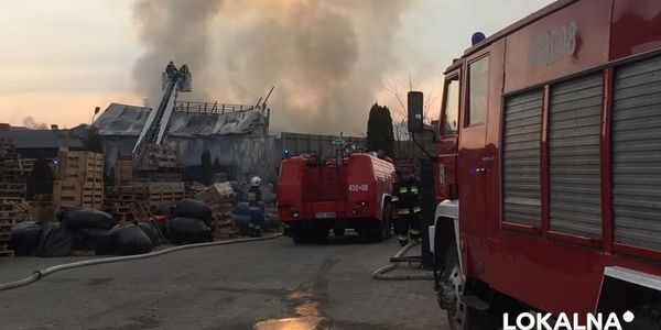 Firefighters take up positions to fight a spreading factory fire in Denkówek, Poland.