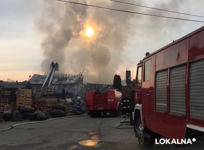 Firefighters take up positions to fight a spreading factory fire in Denkówek, Poland.  - Courtesy of the State Fire Service