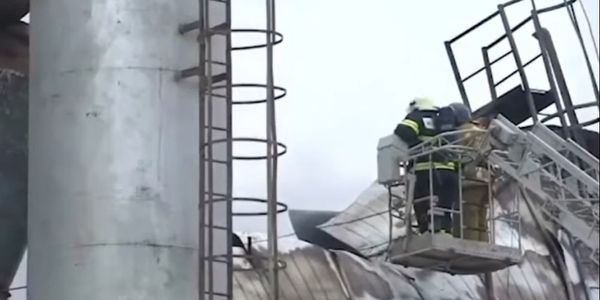 Firefighters inspect the damage to a warehouse near Moscow from above.