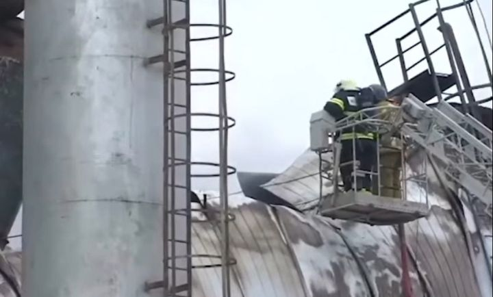 Firefighters inspect the damage to a warehouse near Moscow from above. - Screencapture Via YouTube
