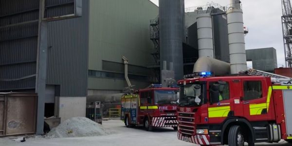 Firefighters arrive at glass plant fire in Elton, England Sunday.