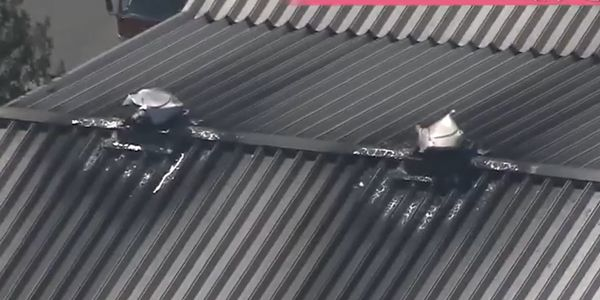 Heat from an indoor ceiling fire melted the ventilation caps on the roof of a Japanese aluminum...