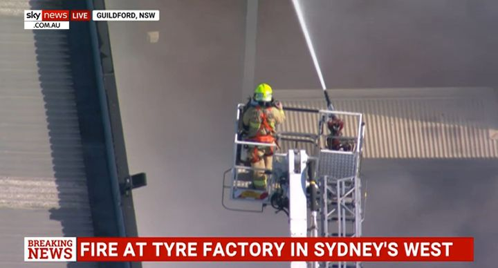 Fire rages at a tire factory near Sydney, Australia. - Screencapture Via SkyNews