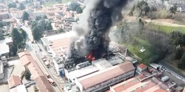 Aerial view of burning plastics plant in Italy.