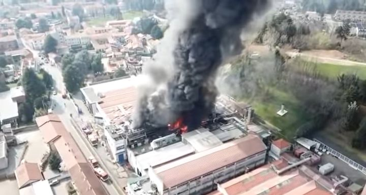 Aerial view of burning plastics plant in Italy. - Screencapture Via YouTube