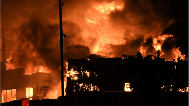 A four-alarm fire destroyed a warehouse in San Francisco's Bayview District. - Screenshot via KTVU.