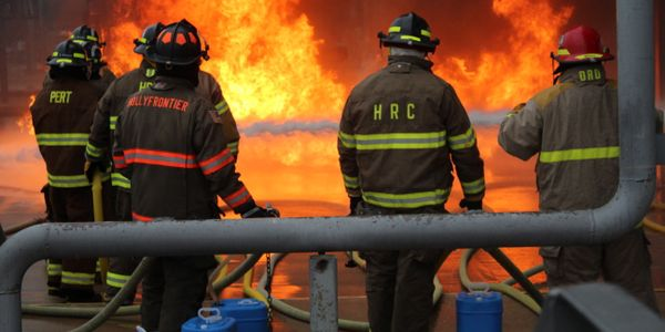 Firefighters tackle a live-fire training project at Brayton Fire Training Field at Texas A&M.