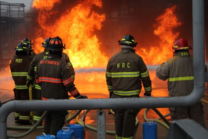 Firefighters tackle a live-fire training project at Brayton Fire Training Field at Texas A&M. -