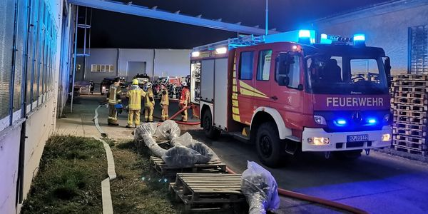 Firefighters assess the fire scene after a blaze at a German textile factory Thursday.