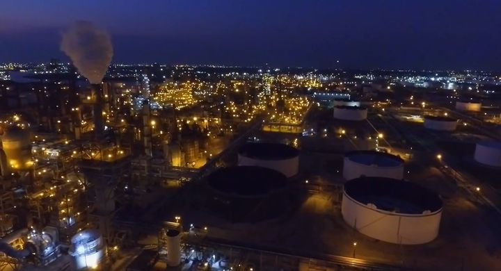 Nighttime aerial shows expansive LyondellBasell complex in Houston. - Screencapture from YouTube