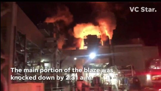 Flames tower above the Proctor and Gamble paper products plant in Oxnard, California. - Screencapture Via VC Star