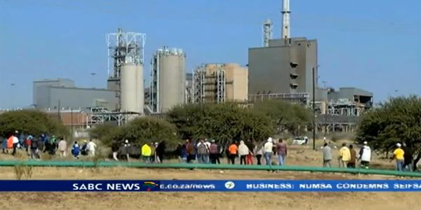 Workers file toward the Anglo American Platinum smelter in Rustenburg, South Africa.