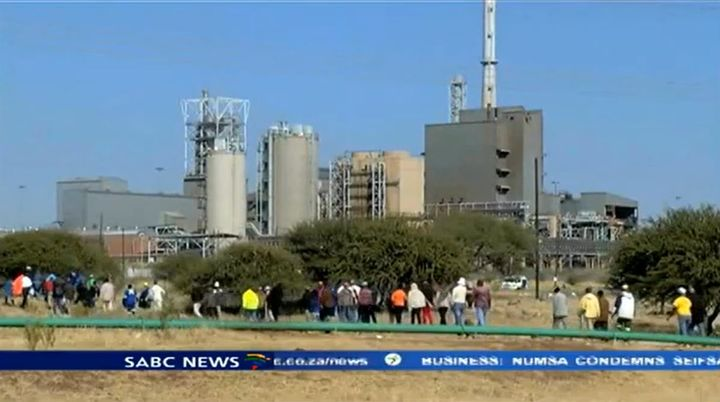 Workers file toward the Anglo American Platinum smelter in Rustenburg, South Africa. - Screencapture Via SABC