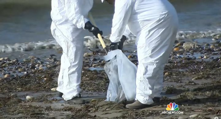 Workers clean up Refugio State Beach in California after a 2015 oil spill. - Screencapture Via Twitter