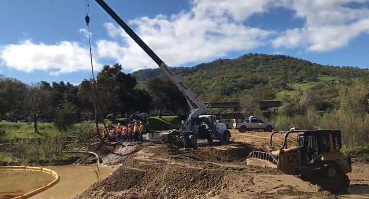 Heavy equipment was needed to help contain crude oil that spilled into California's Cuyama River. - Courtesy of Santa Barbara County Fire Department