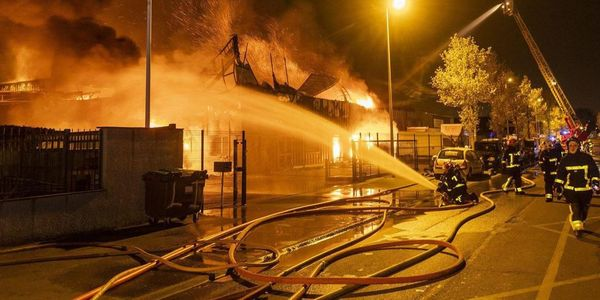 An estimated 60 firefighters battled the furniture factory fire Thursday in Brie-Comte-Robert,...
