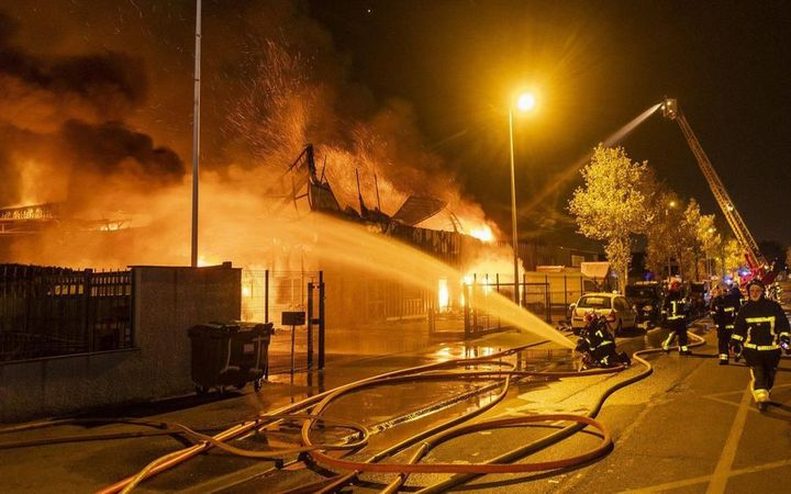 An estimated 60 firefighters battled the furniture factory fire Thursday in Brie-Comte-Robert, France. - Photo courtesy of SDIS 77