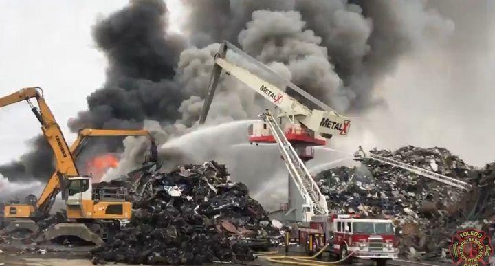 Firefighters battle scrap yard blaze in Delta, Ohio, near Toledo. - Courtesy of Toledo Fire & Rescue