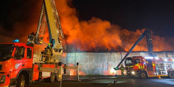 Flames destroyed a warehouse storing textiles in Adlington, England.